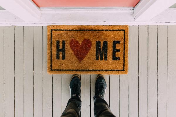 Feet and Welcome Home door mat