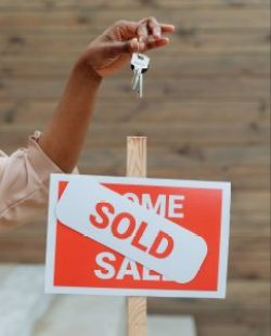 Sold sign with house key