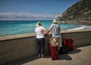 Retirees looking onto ocean