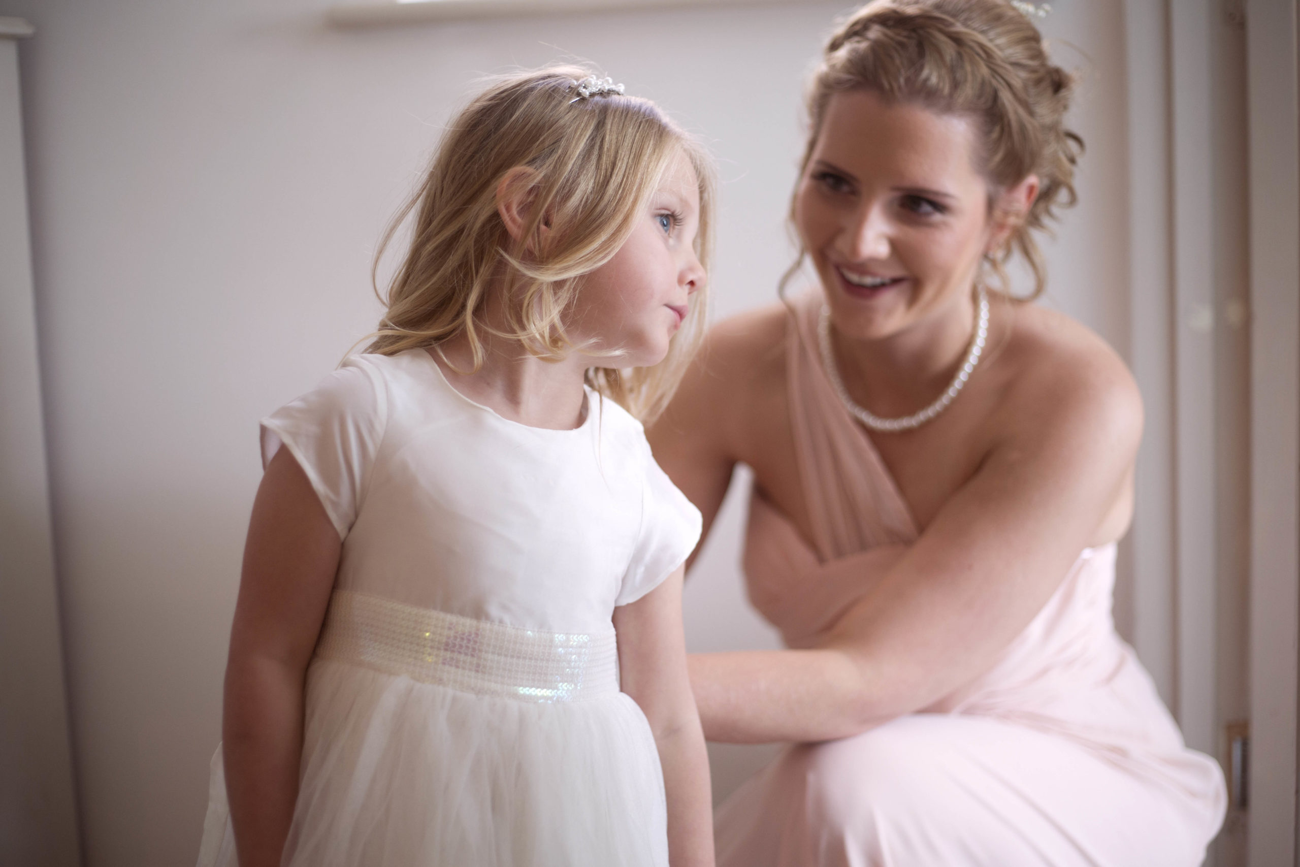 Bridesmaid and flower girl getting ready for wedding day Bristol wedding photographer