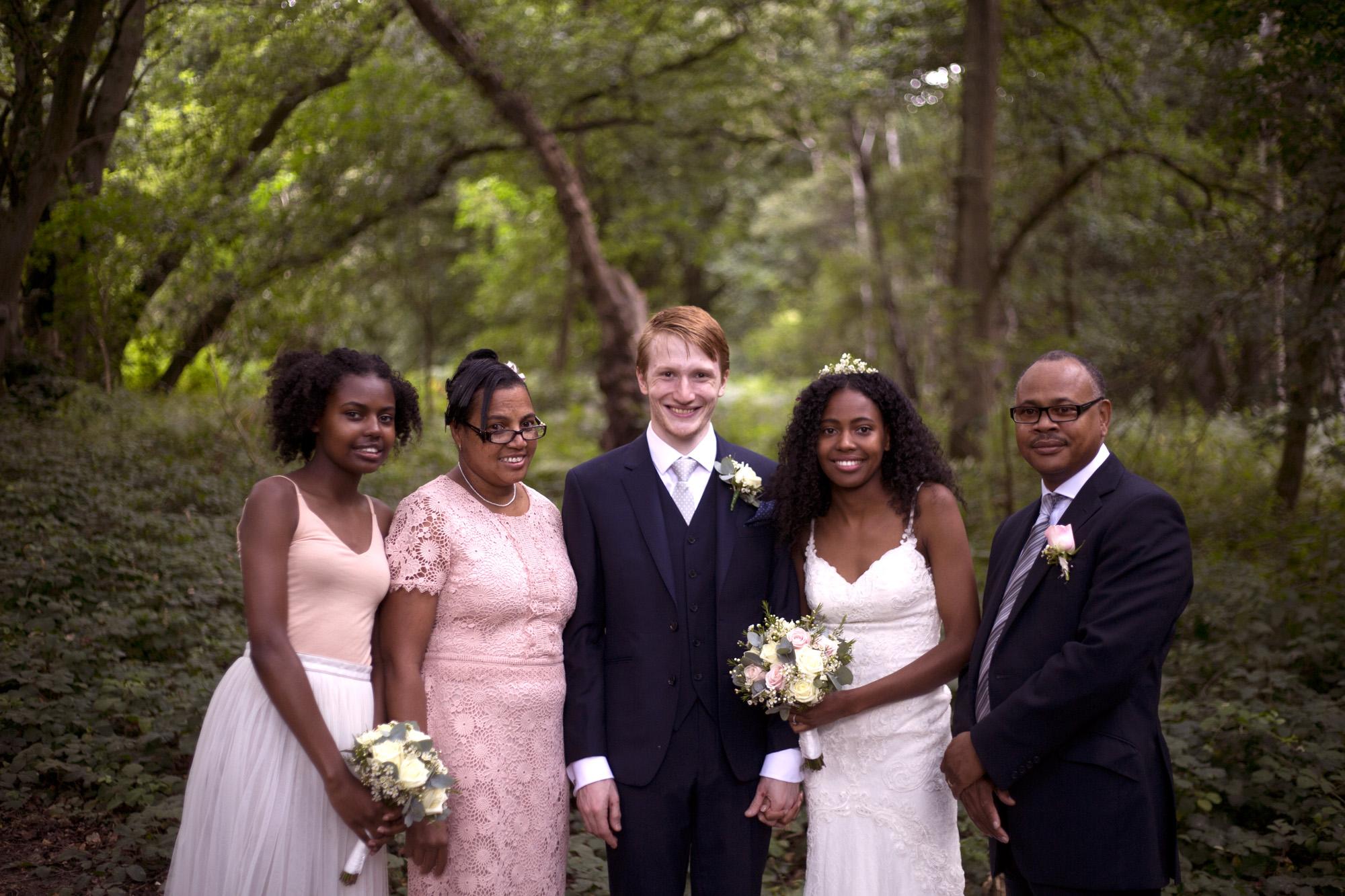 Family portrait pinks and blues woodland wedding photographer