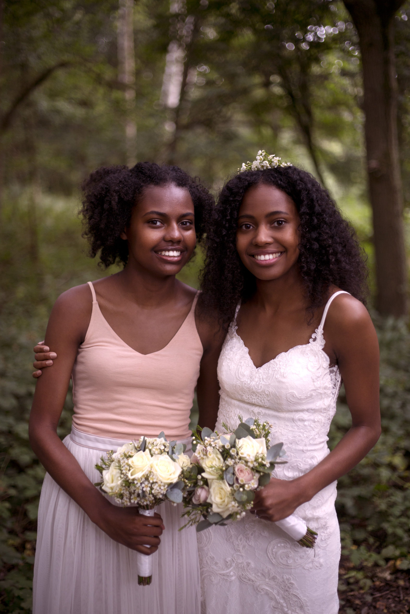Bride and her sister the maid of honour woodland wedding photographer