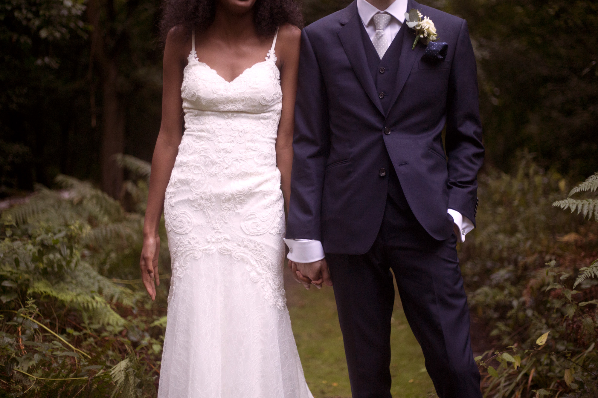 Groom in navy suit and bride in Essence of Australia wedding dress at Cuffley camp outdoor woodland wedding photographer