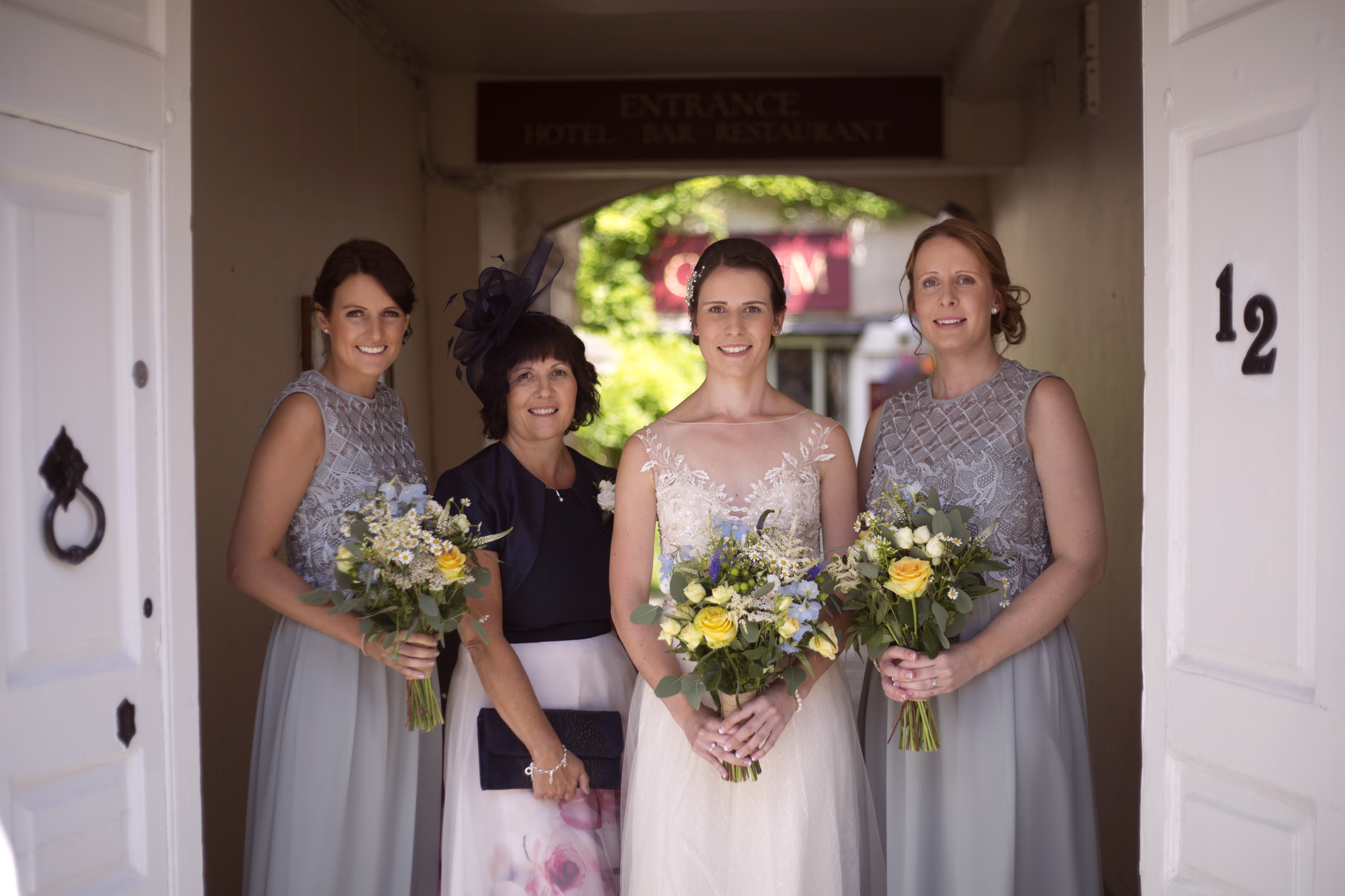 Bride with bridesmaids mother of the bride in Cripps barn wedding photographer Gloucestershire