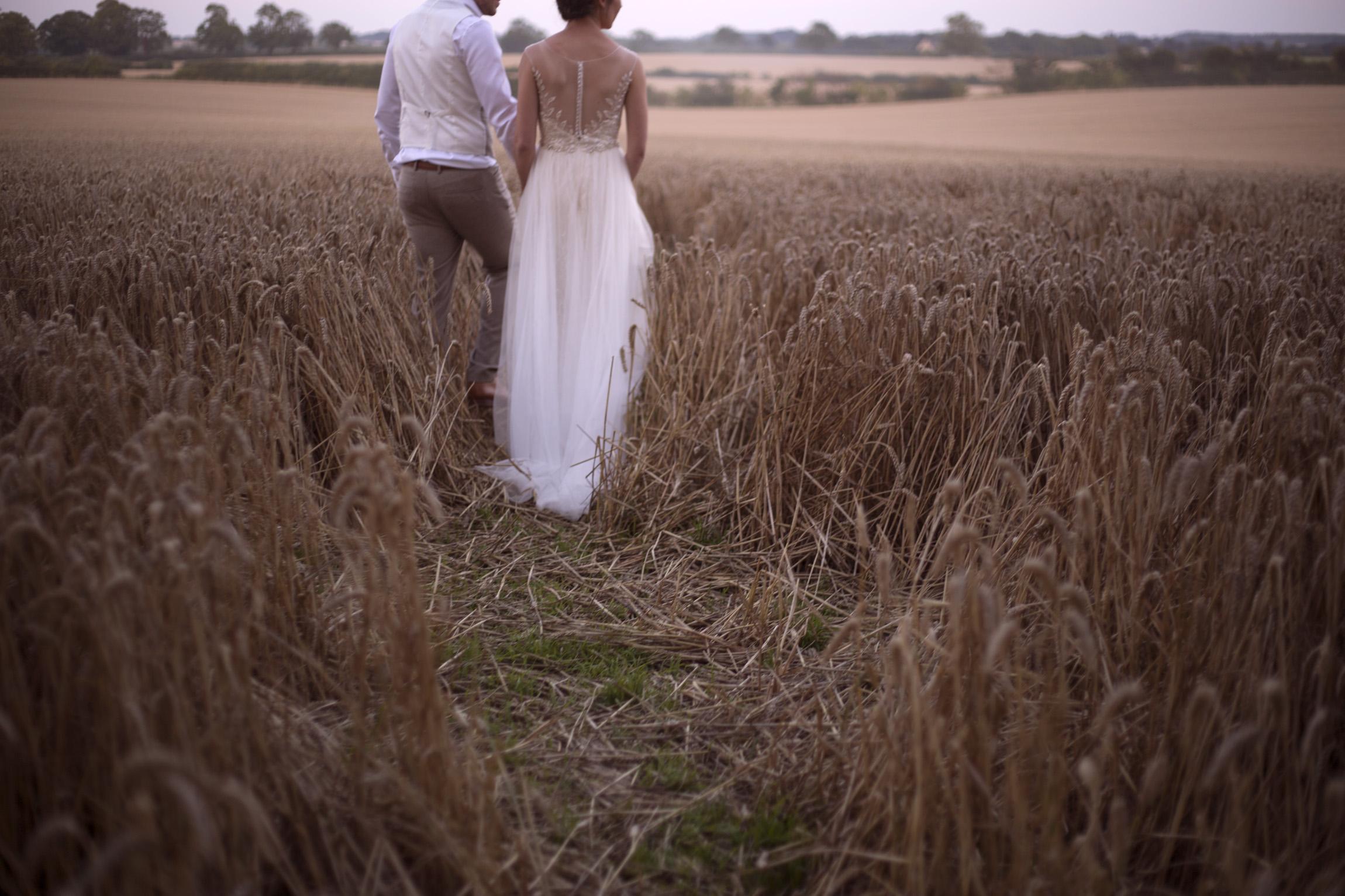 Bride and groom walking portrait shoot in cornfield Cripps barn outdoor wedding photographer