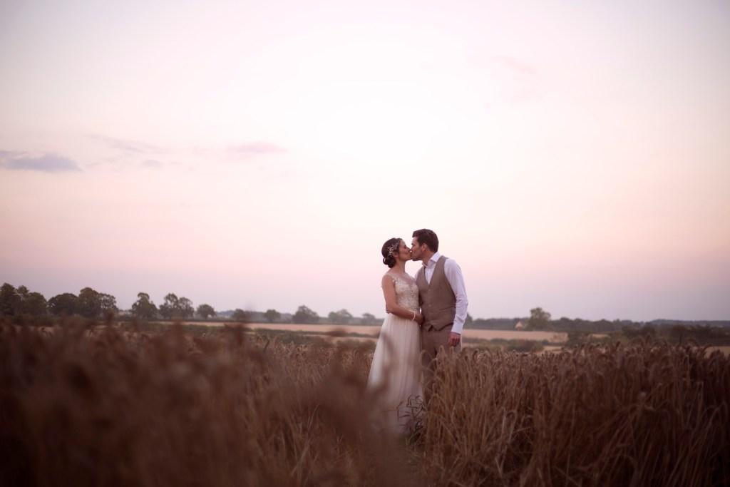 Kissing bride and groom portrait shoot in cornfield Cripps barn outdoor wedding photographer