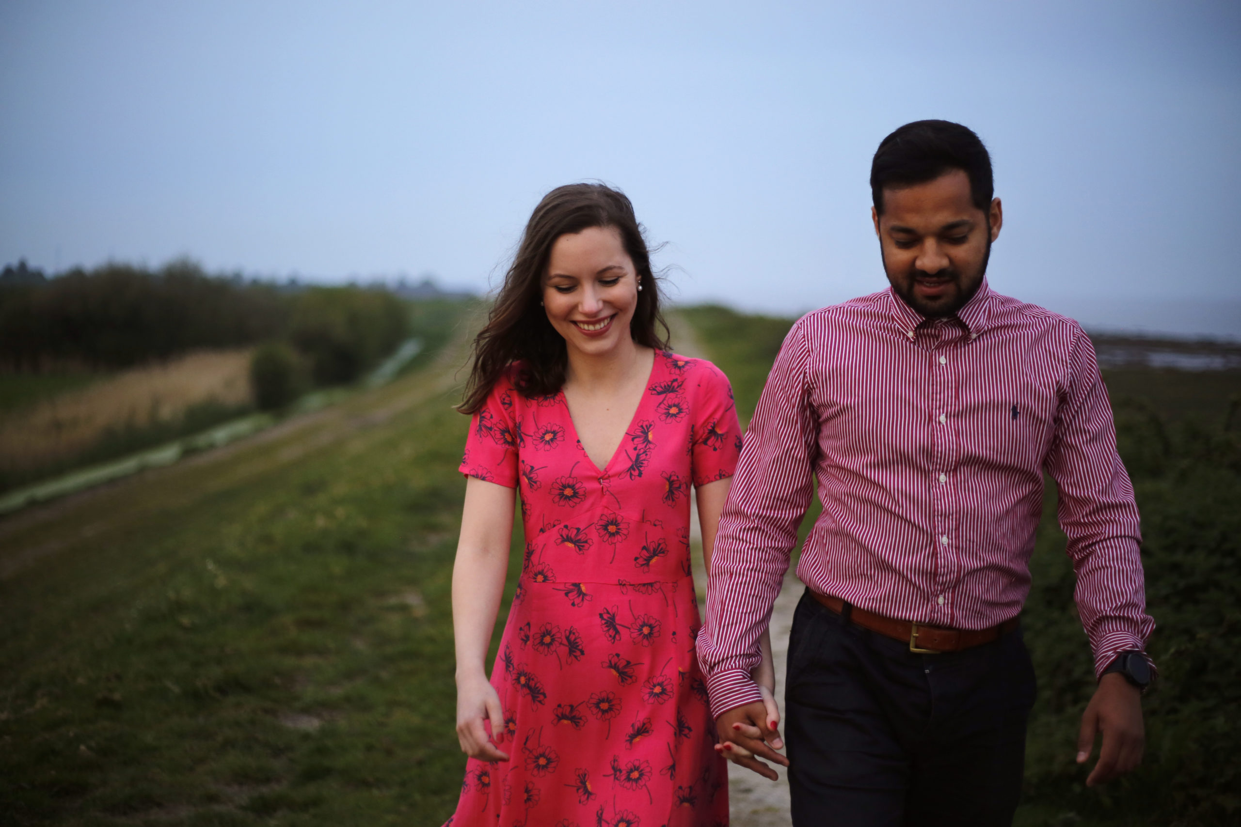 Engagement shoot holding hands walking by the sea Wentloog Levels