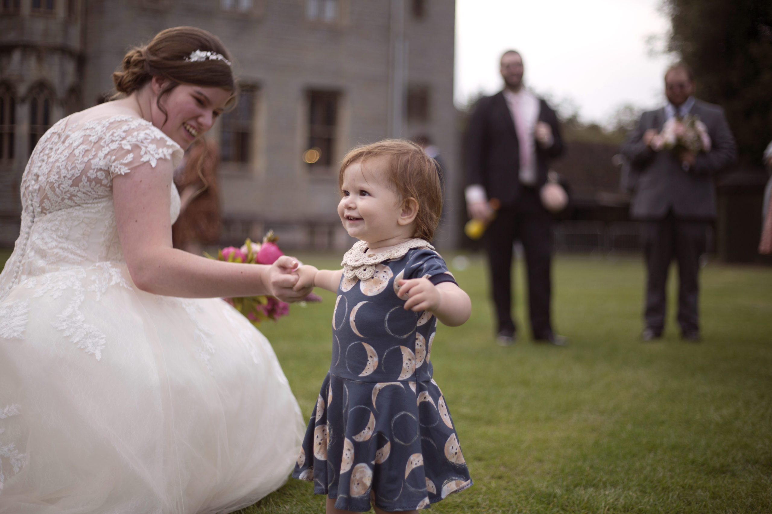 Bride playing with children after the ceremony Cardiff Castle Wedding Photographer St Teilos