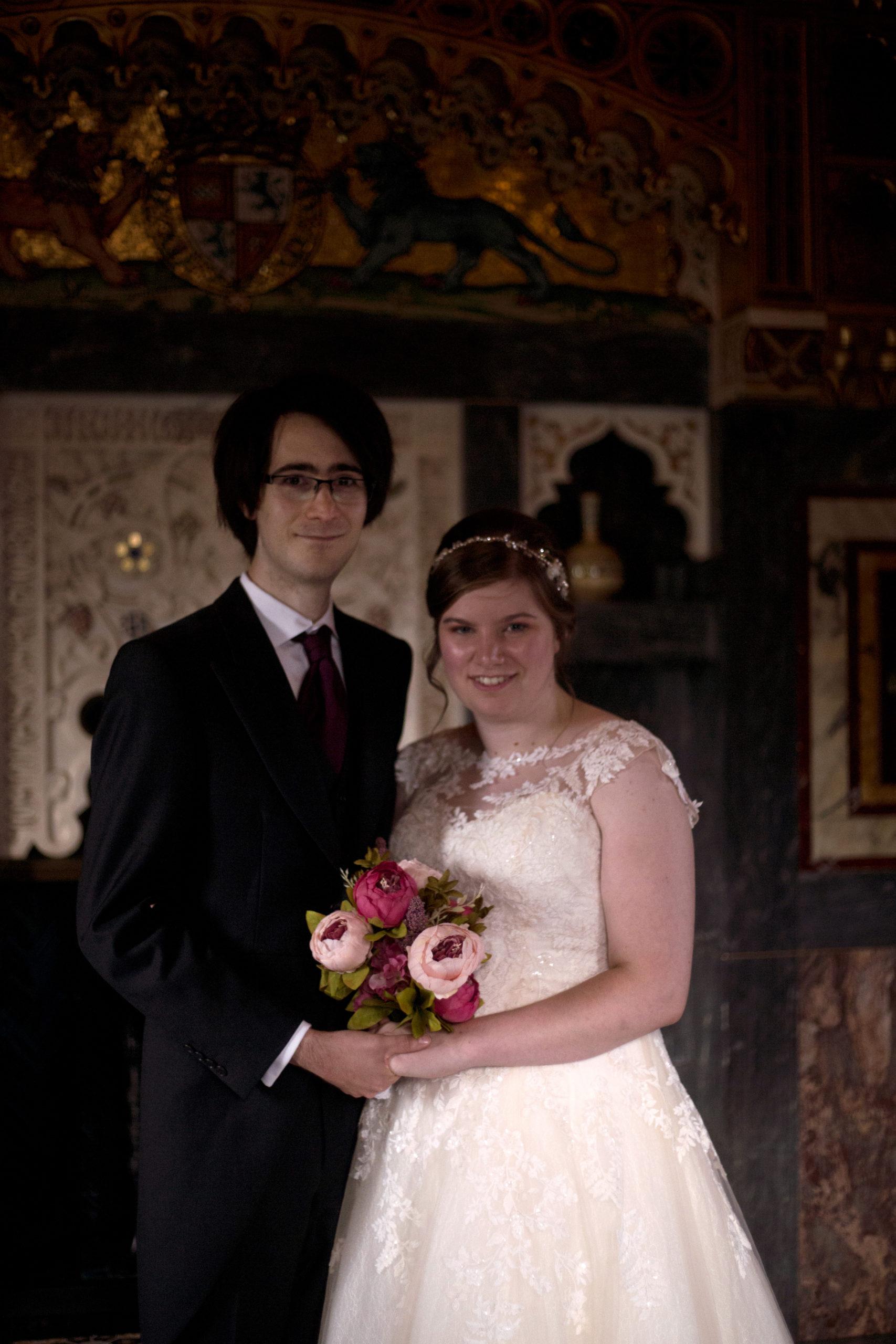 Bride and groom smiling in Arab room Cardiff Castle Wedding Photographer St Teilos church