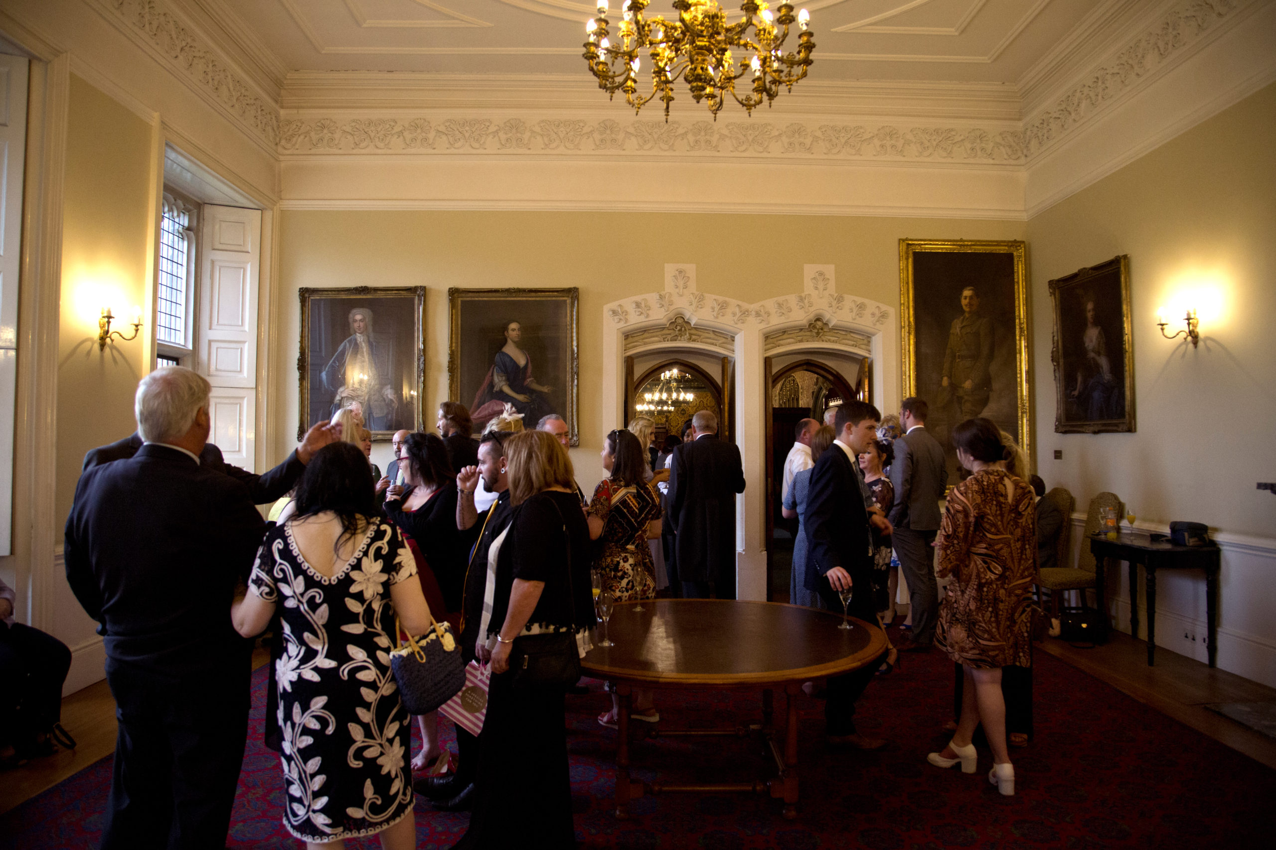 Wedding guests socialising after the ceremony library Cardiff Castle Wedding Photographer St Teilos