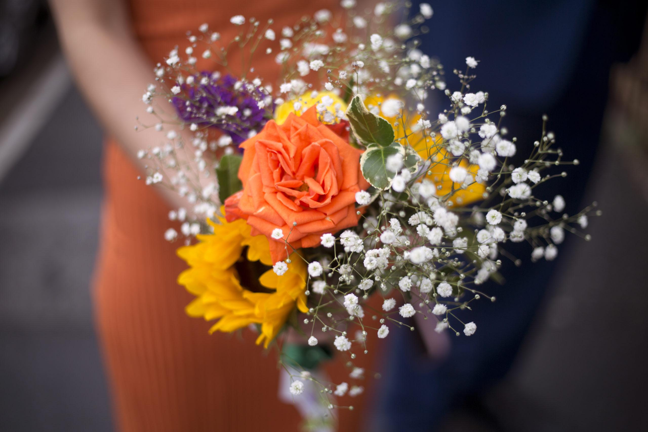 Bridesmaid's sunflower rose gypsophila bouquet micro wedding photographer Bristol