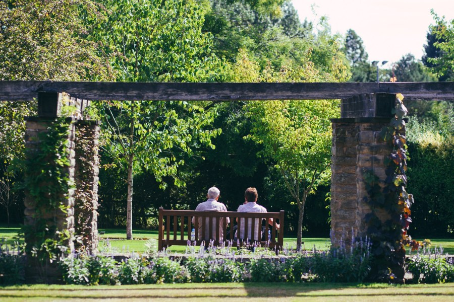 Couple enjoying the gardens in summer