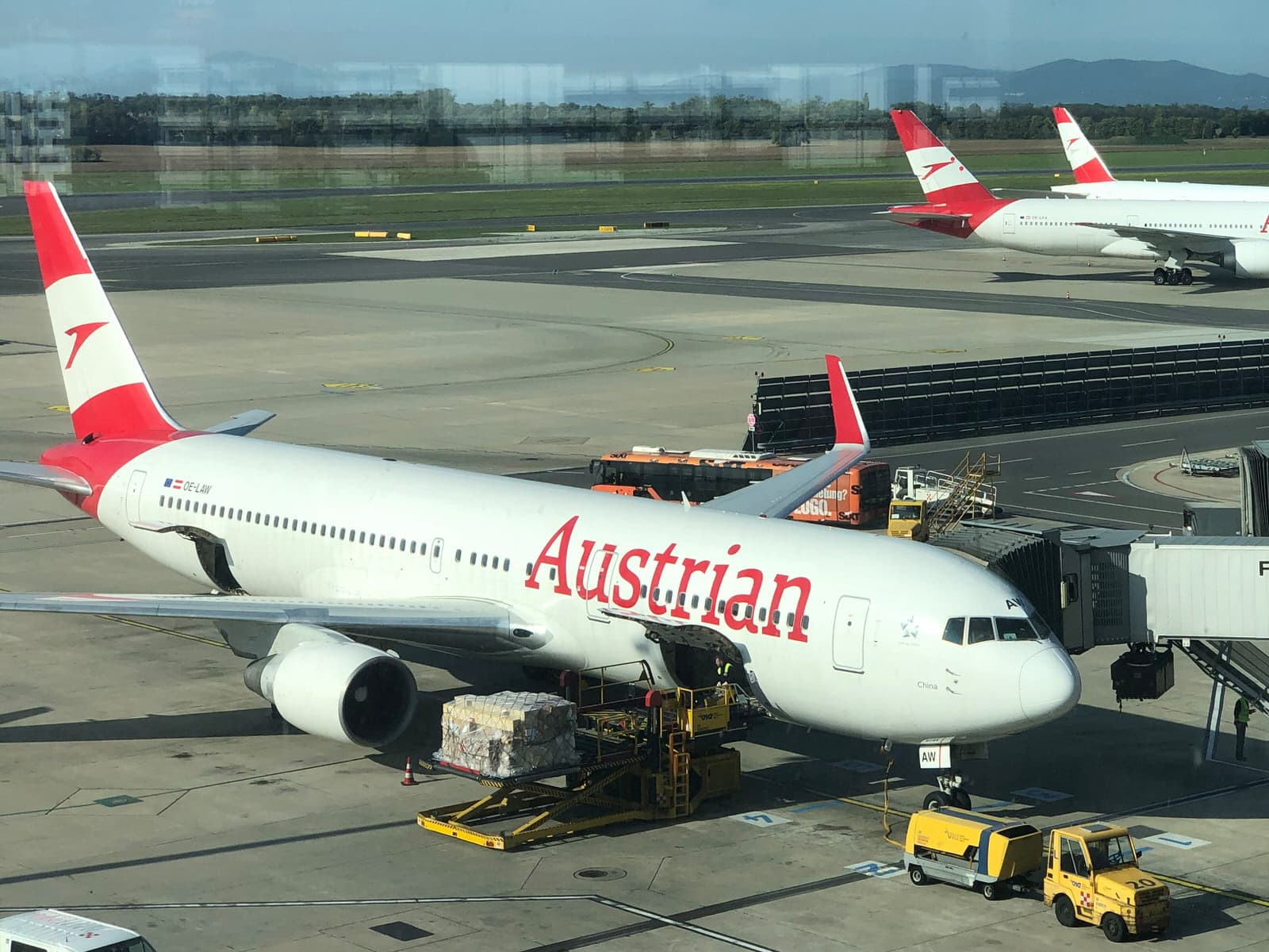 An Austrian Airlines aircraft taking on cargo at the gate at Vienna International Airport