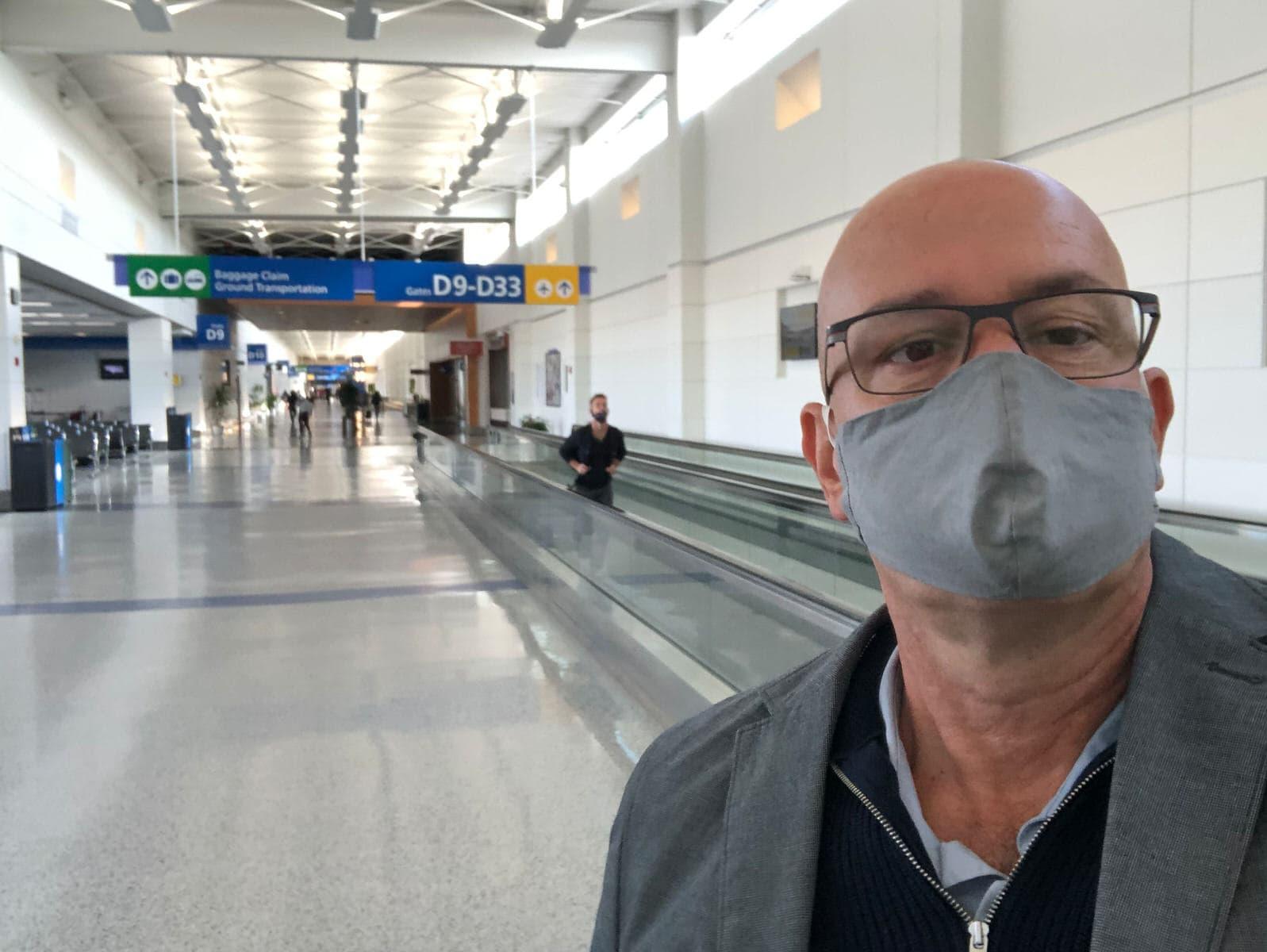 Steven Graffham wearing a mask at a very quiet Detroit International airport