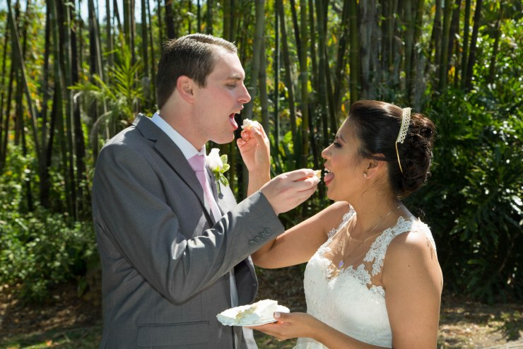 Couple feed each other wedding cake