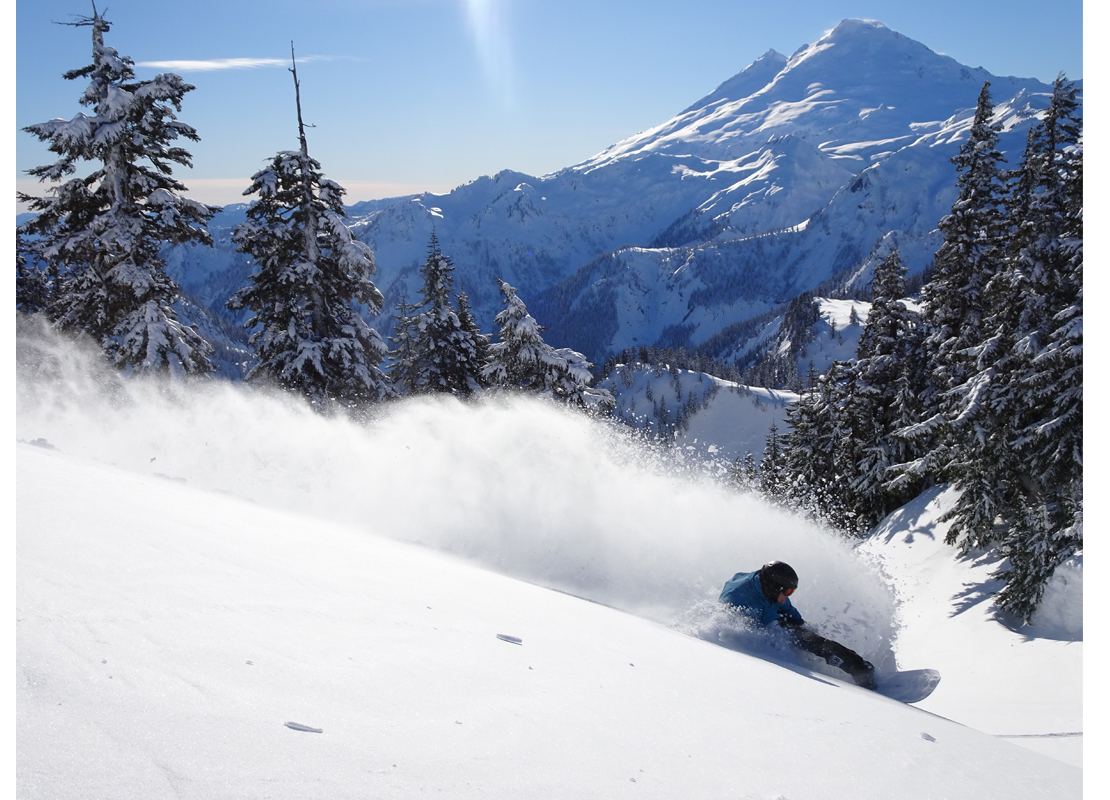 Jason Cannon lays down a slash in front of Mt Baker Washington