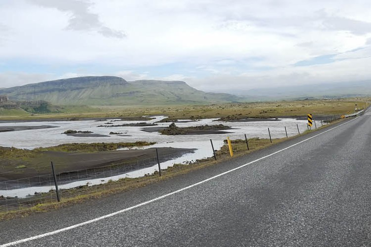 Driving in Iceland. Two lane road with dramatic scenery.
