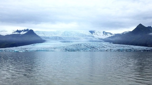 Glacial lagoon with a large glacier entering the water.