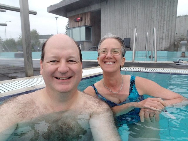 Selfie of a man and woman in a small pool.