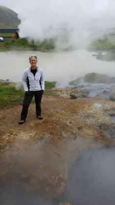 Woman standing between geothermal pools