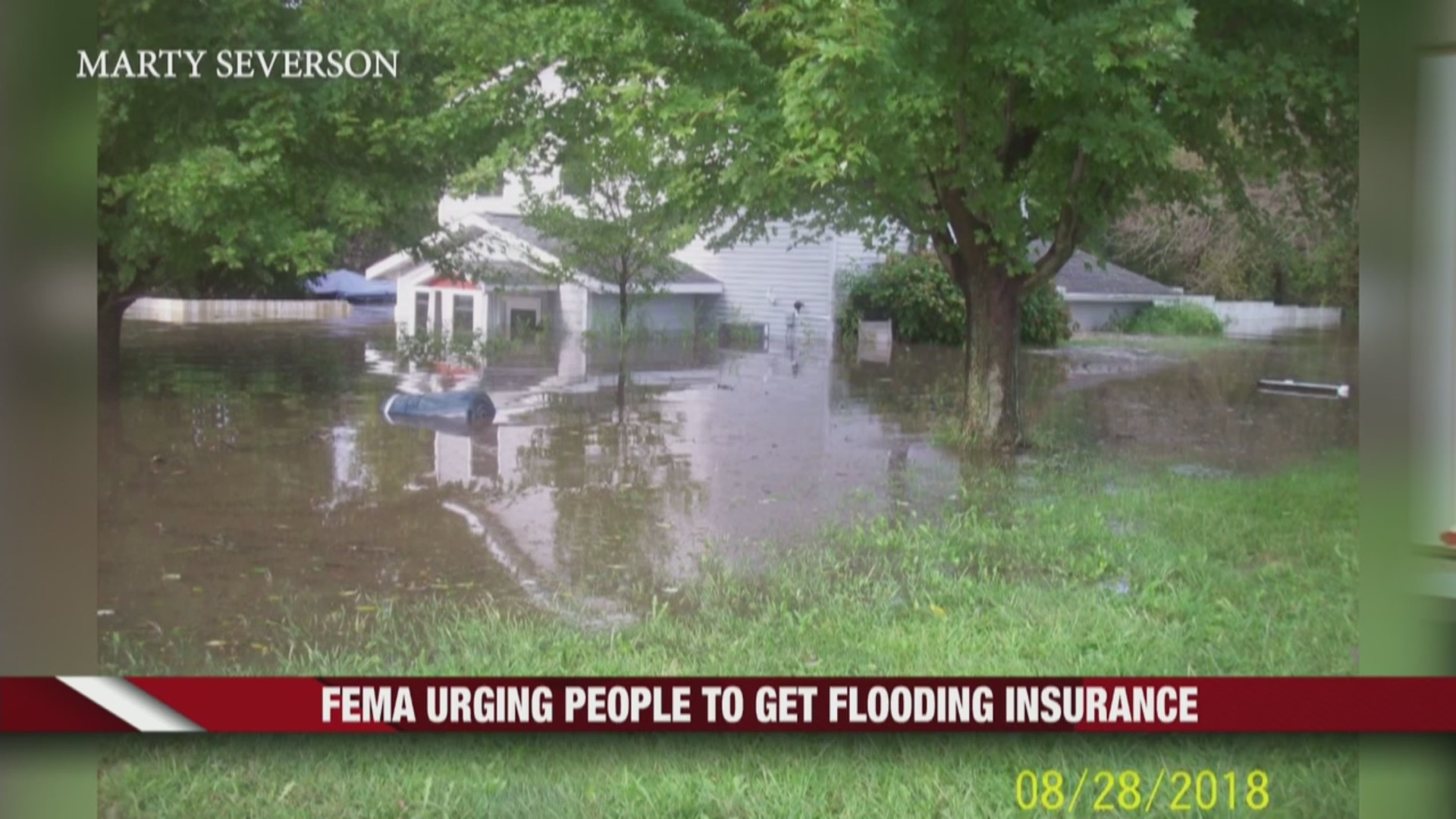 Flooded house FEMA urges flood insurance