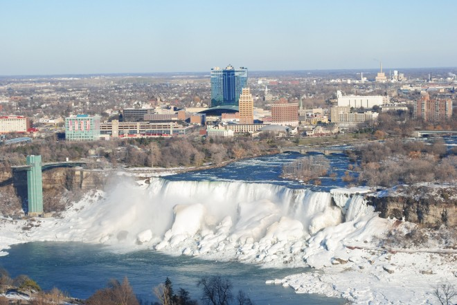 The American Falls in winter, still flowing.