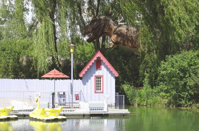 T-Rex lurking in the background of the swan boats at Wonderland.