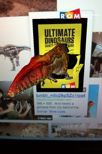 Dinosaur bursting out of the ad frame with the help of the free ROM app.