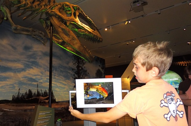Using iPads to flesh out the dinosaurs.