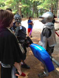 KIds confer before heading into battle at a Guard Up! Wizards & Warriors program (Photo: Ethan Gilsdorf)