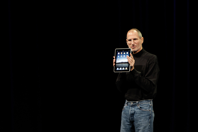 Apple iPad, in the hands of Apple CEO Steve Jobs