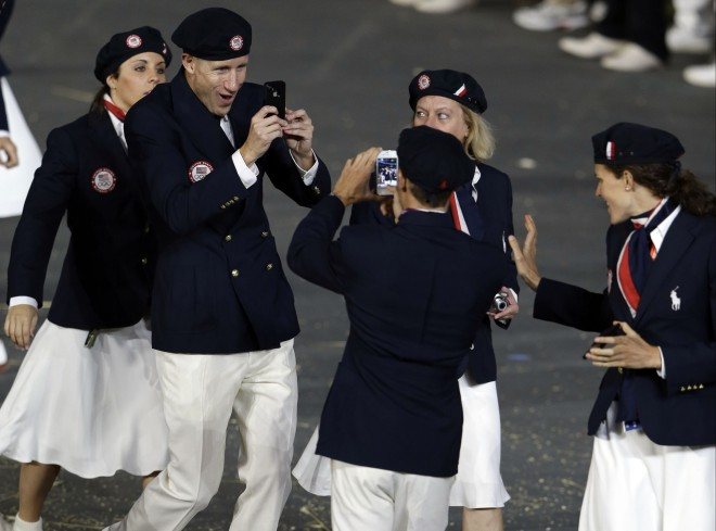 US athletes marching during the Opening Ceremony at the 2012 Summer Olympics wanted to be sure to capture the moment on their phones. Photo: AP Photo/Mark Humphrey