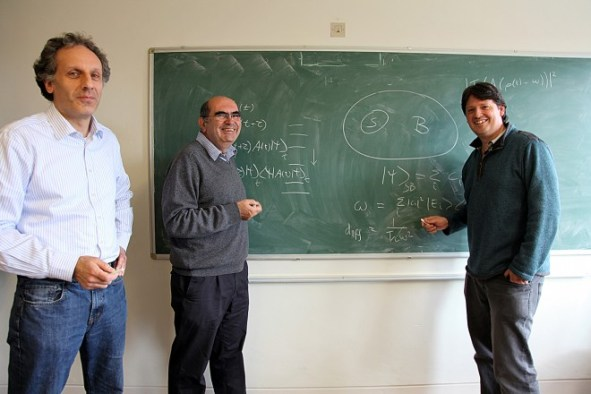 """A watershed paper by Noah Linden, left, Sandu Popescu, Tony Short and Andreas Winter (not pictured) in 2009 showed that entanglement causes objects to evolve toward equilibrium. The generality of the proof is """"extraordinarily surprising,"""" Popescu says. """"The fact that a system reaches equilibrium is universal."""" The paper triggered further research on the role of entanglement in directing the arrow of time. Photo: Courtesy of Tony Short"""