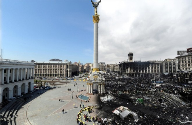 This combination of pictures shows Independence Square in Kiev on April 22, 2009 during a social movement called 'Smile Ukraine! Smile overcomes a crisis!' organized by students (left) and the same square pictured on February 20, 2014, three months after a political crisis erupted leaving around 60 dead.