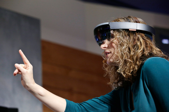 Microsoft's Lorraine Bardeen demonstrates HoloLens at the Windows 10 event at the company's headquarters in Redmond, Washington on Wednesday, Jan. 21, 2015.