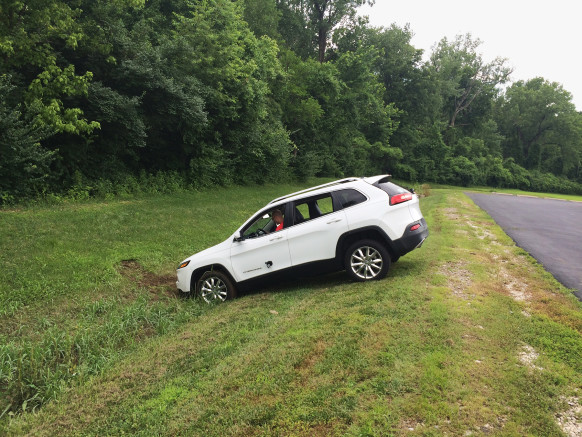 Miller attempts to rescue the Jeep after its brakes were remotely disabled, sending it into a ditch.