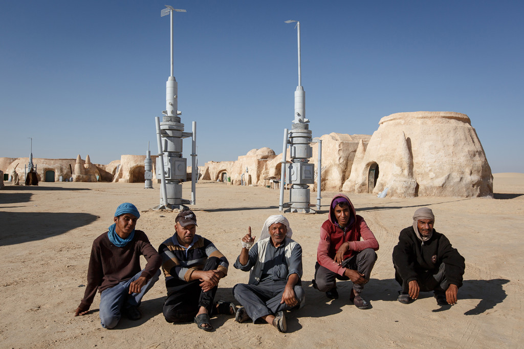 Ben Said and other locals who take turns living in the Mos Espa set pose for a photo. Near Ong Jemel, Tunisia.