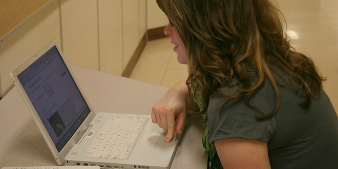 Student doing homework on a laptop computer.
