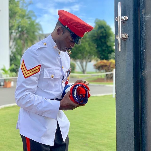 A Royal BERMUDA Regiment soldier unfolds the Bermuda ?? flag, at the beginning of the reconvening of Parliament on Friday.