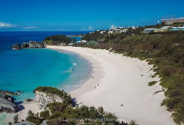 An unusual angle from the air of Bermuda's most famous beach, the Horseshoe Bay. It's a fabulous stretch of pink soft sand. You need to see it and feel it to believe it. The Fairmont Southampton Princess sits up on the hill in the background.