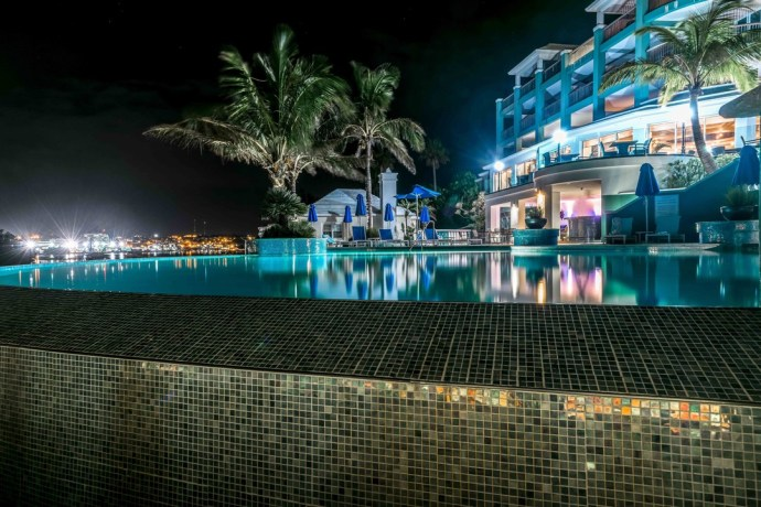 The Newstead Belmont Hills Hotel and Spa at night, by the pool.