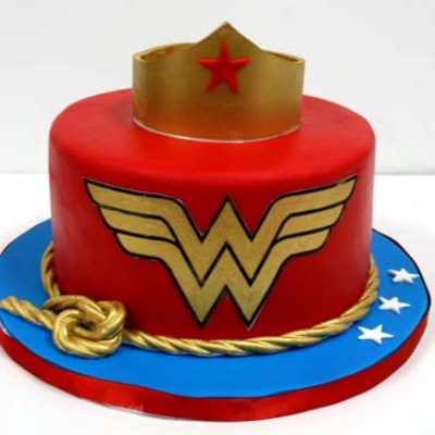 Wonder Woman Cake wish a cupcake