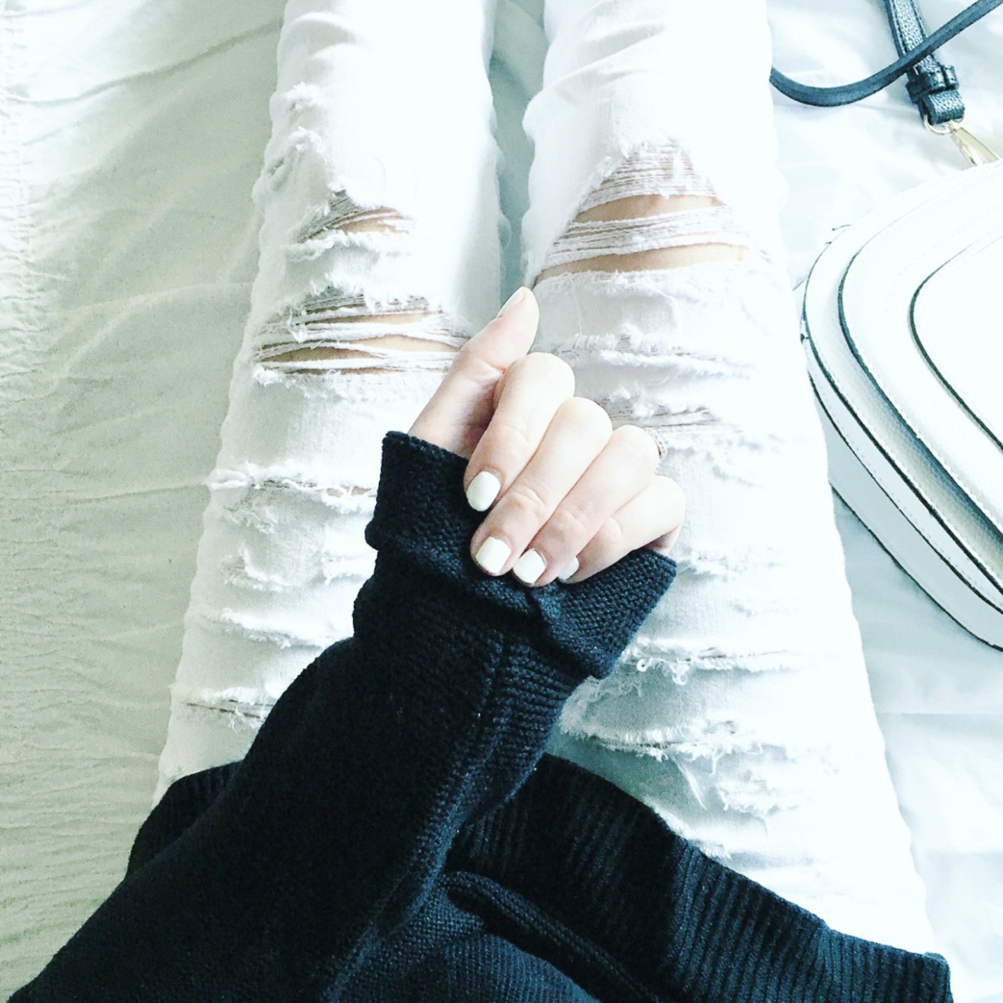 instagram-white-manicure-cozy-black-sweater-white-distressed-jeans-black-and-white-outfit