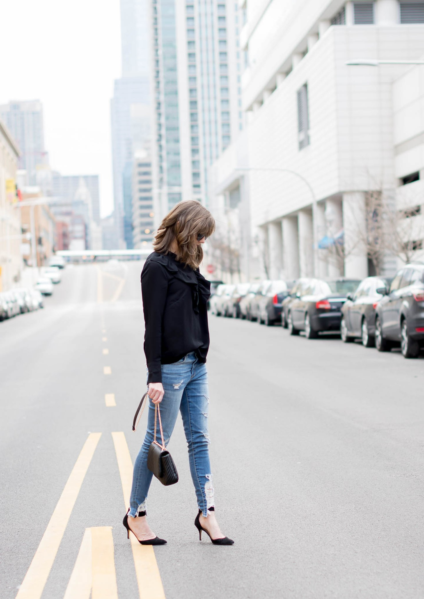 ruffled blouses, h&m black bib ruffle blouse, the best distressed skinny jeans, american eagle high rise jeggings, how to mix dressy and casual, my favorite ruffled blouses