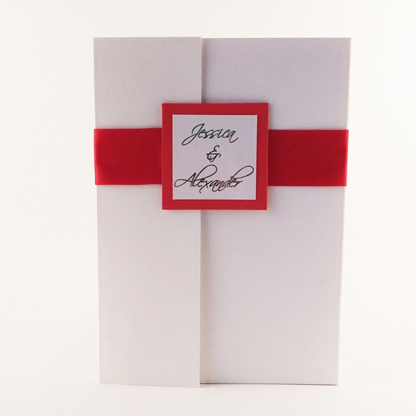 Red, gold and white pocketful wedding invitation available in our online shop.
