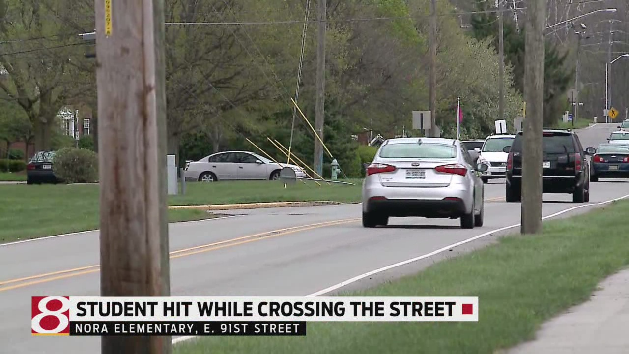 First grader struck in front of his school, dies