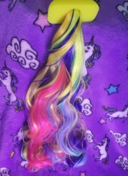 The tail of the Rainbow Unicorn Tail Plug.