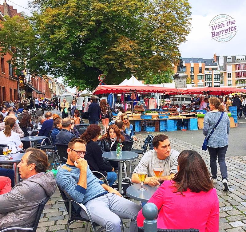 Sidewalk cafes full of people