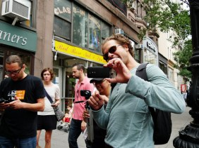 """Digital lead Michael Cervieri demonstrates how you should always turn your phone sideways and film in """"landscape"""" mode when filming on a mobile device."""