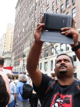 Program manager for Asia Arul Prakkash uses InformaCam to take a picture of the crowd.